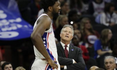 Joel Embiid pictured with head coach Brett Brown