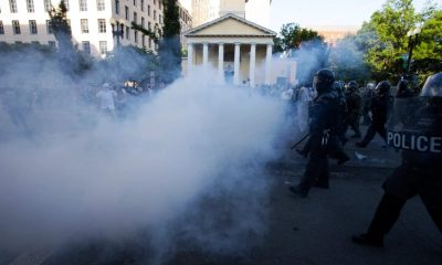 Protesters clashed with police in a plume of tear gas. (Image via Jose Luis Magana/AFP/Getty Images)