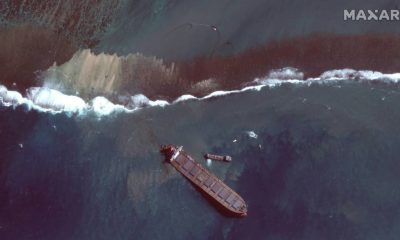 This satellite image shows an aerial view of the MV Wakashio off the southeast coast of Mauritius. (2020 Maxar Technologies via AP)