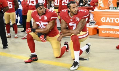 The now iconic photograph of Eric Reid and Colin Kaepernick kneeling at a 49ers game in 2016. (Thearon W. Henderson/Getty Images)