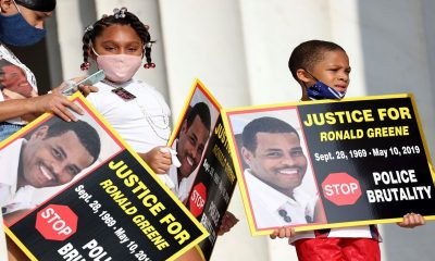 Family members of Ronald Greene listen to speakers during a protest in Washington, DC. (Michael M. Santiago/Pool via AP)