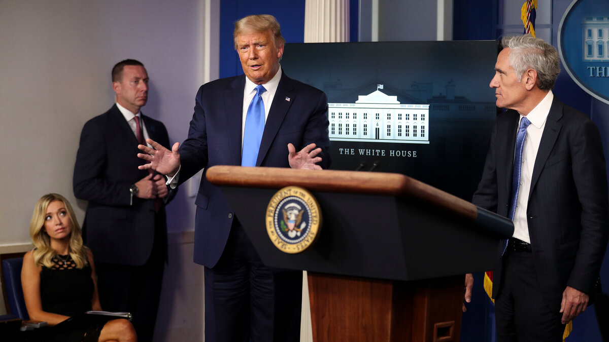 President Donald Trump with Scott Atlas, coronavirus adviser, during a press briefing at the White House Wednesday. (Image via Oliver Contreras/New York Times)