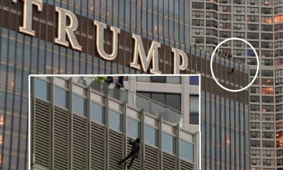 Close up of the man hanging off the Trump Tower on North Wabash Avenue, Chicago, IL on October 19th, 2020. (Image via FOX 32 Chicago)