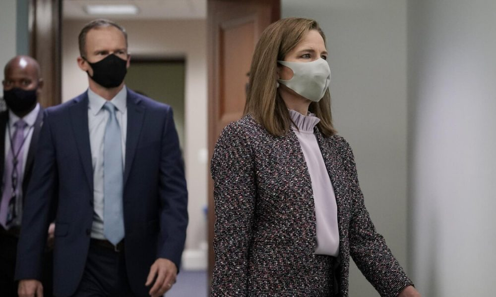 Supreme Court nominee Amy Coney Barrett arrives Wednesday for the third day of her confirmation hearing with the Senate Judiciary Committee. (J. Scott Applewhite/AP)