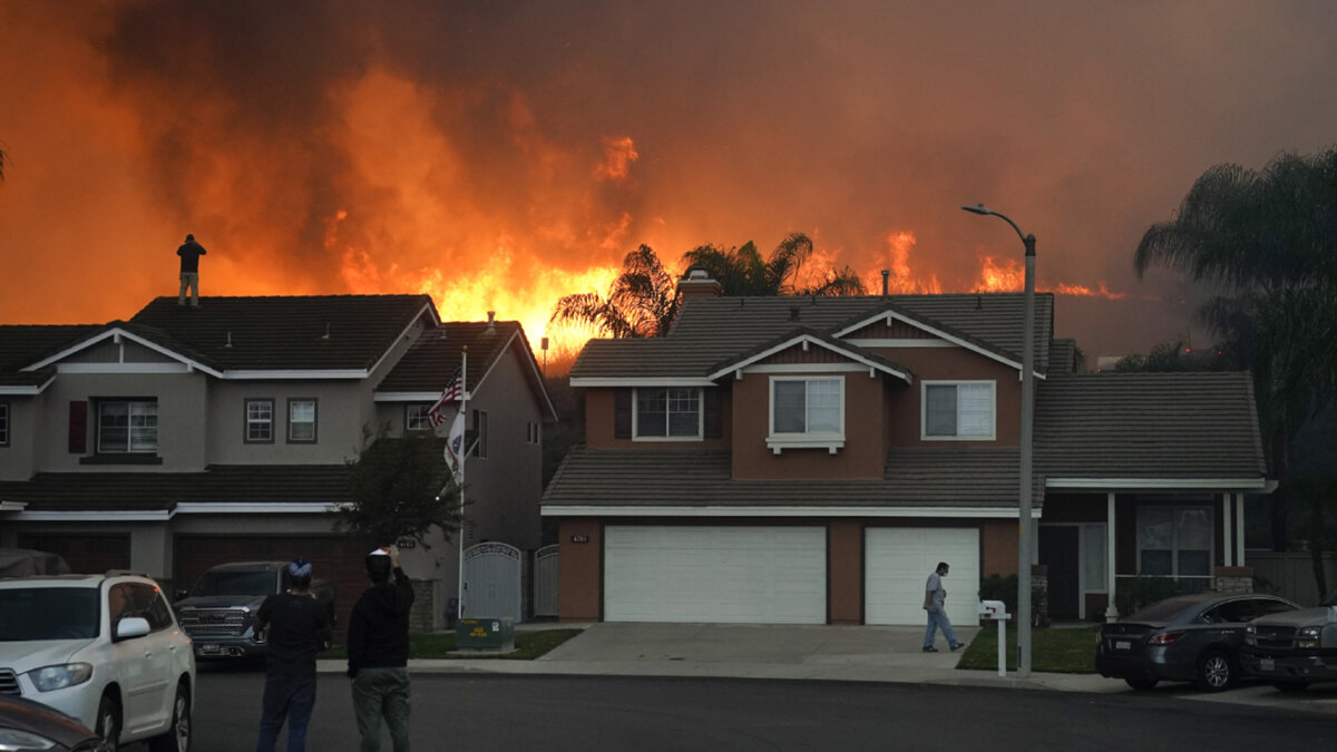 Residents stare at the looming Blue Ridge fire that's threatening hundreds of homes in the area. (Image via ABC7)